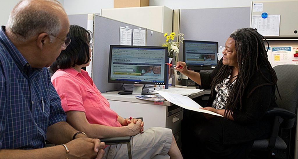 Seniors receiving counseling about insurance, Medicare and Medicaid